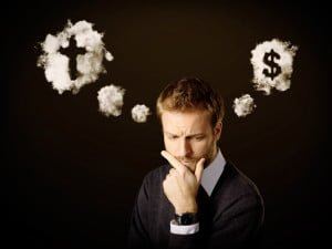 A man pondering between money and God