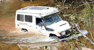 Troopy Crossing a Creek