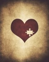 A heart on a texture background with a puzzle piece missing