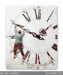 A man hangs on a big time clock