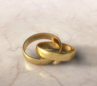 Two golden wedding rings, inseparably linked.