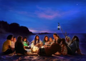 People on Beach Sitting Around a Fire with Jesus